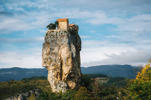Katskhi pillar. Georgian landmarks. The church on a rocky cliff. Katskhi pillar. Georgian landmarks. Man's monastery near the village of Katskhi. The orthodox church and the abbot cell on a rocky cliff. Imereti, Georgia. Georgian Meteora monastery stock pictures, royalty-free photos & images