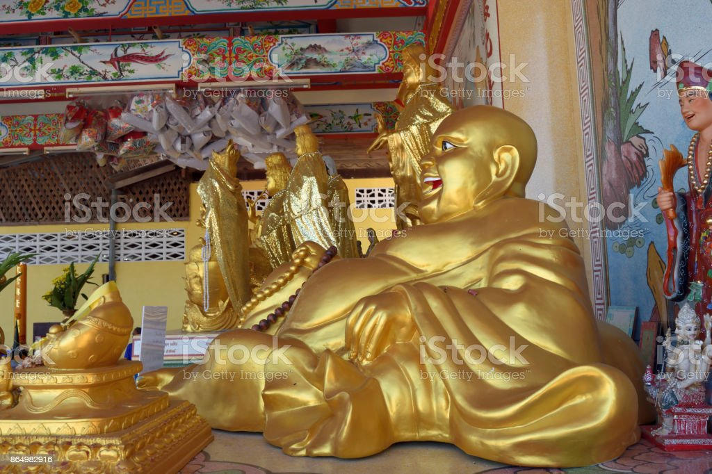 Katyayana or Kasennen golden statue in Thailand stock photo