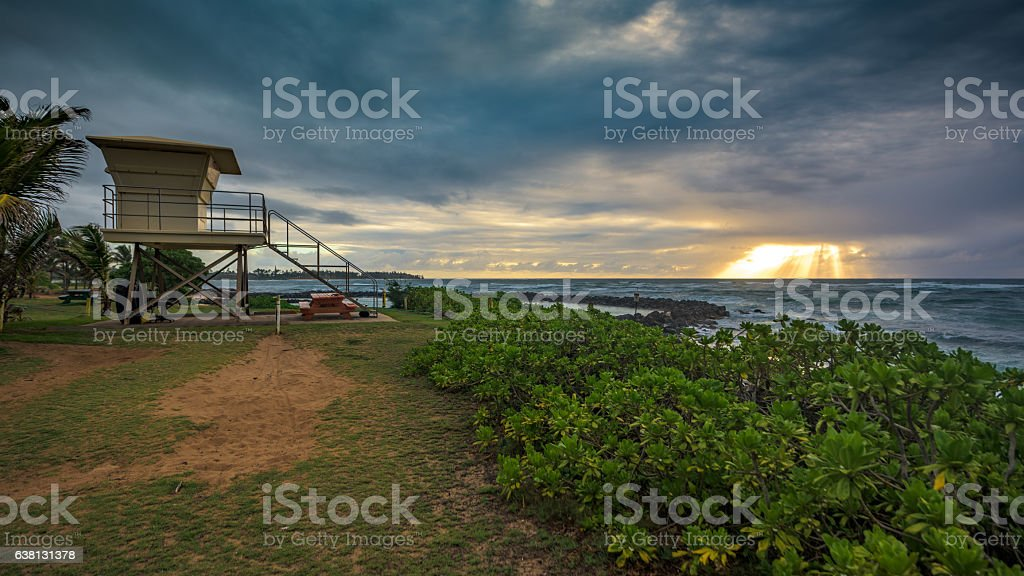 Kauai cloudy sunrise, seen from Lydgate State Park stock photo