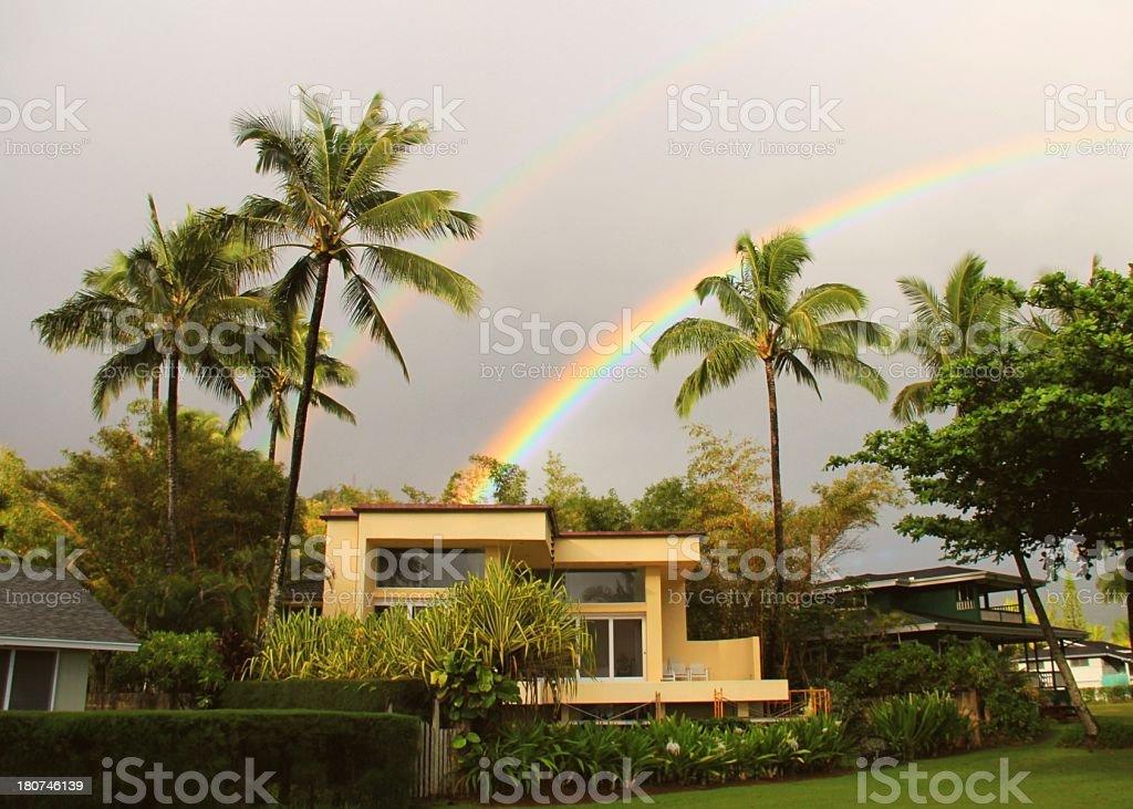 Kauai Hawaii home palm trees and double rainbow stock photo