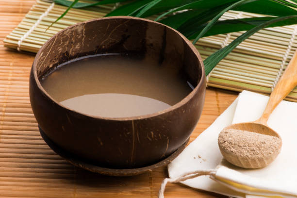 Kava drink made from the roots of the kava plant mixed with water stock photo