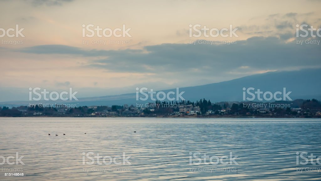 Kawaguchi Lake With Cloudy Sky And Fuji Mountain Background (soft Focus)  With Group Of