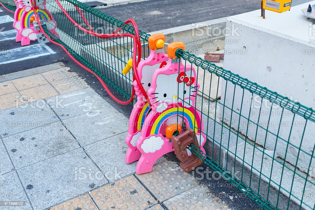 Kawaii Hello Kitty Road Works Barricades in Osaka, Japan stock photo
