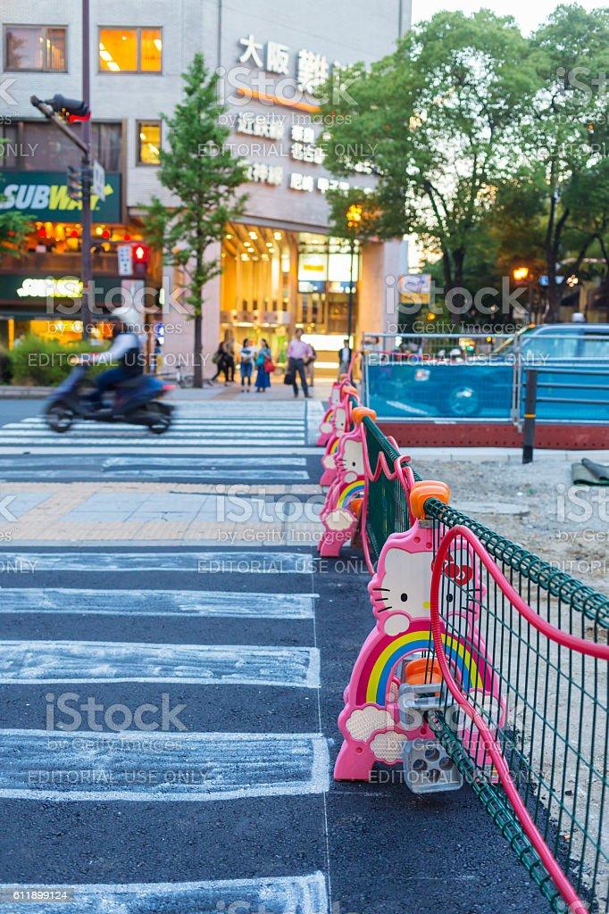 Kawaii Hello Kitty Road Works Barricades in Osaka, Japan stock photo