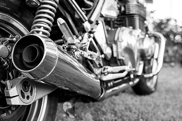 Kawasaki motorcycle parked in the backyard Subotica, Serbia - Jun 13, 2015: Photo shoot of Kawasaki ZR 1100 Zephyr A1 bike from 1992, close up shoot of chromed exhaust and chrome parts on rear end of a bike. Four stroke transverse four cylinder,1062cc, air cooled. Black and white photo. Photographed in the family house backyard in Subotica, Serbia kawasaki heavy industries stock pictures, royalty-free photos & images