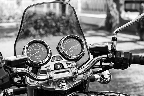 Kawasaki motorcycle parked in the backyard Subotica, Serbia - Jun 13, 2015: Photo shoot of Kawasaki ZR 1100 Zephyr A1 bike from 1992, close up shoot of a steering wheel, speedometer, handles, tachometer and chrome parts. Four stroke transverse four cylinder,1062cc, air cooled. Black and white photo. Photographed in the family house backyard in Subotica, Serbia.Selective focus: tachometer kawasaki heavy industries stock pictures, royalty-free photos & images
