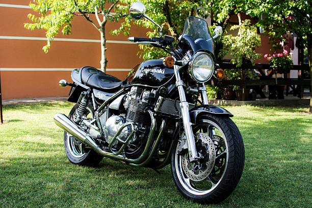 Kawasaki motorcycle parked in the backyard Subotica, Serbia - Jun 13, 2015: Photo shoot of Kawasaki ZR 1100 Zephyr A1 bike from 1992, close up shoot of whole bike, exhaust and chrome parts. Four stroke transverse four cylinder,1062cc, air cooled. Photographed in the family house backyard in Subotica, Serbia. kawasaki heavy industries stock pictures, royalty-free photos & images