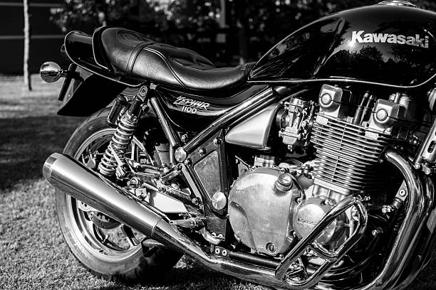 Kawasaki motorcycle parked in the backyard Subotica, Serbia - Jun 13, 2015: Photo shoot of Kawasaki ZR 1100 Zephyr A1 bike from 1992, close up shoot of rear of a bike, exhaust and chrome parts.1062cc. Four stroke transverse four cylinder,1062cc, air cooled. Black and white photo. Photographed in the family house backyard in Subotica, Serbia. kawasaki heavy industries stock pictures, royalty-free photos & images