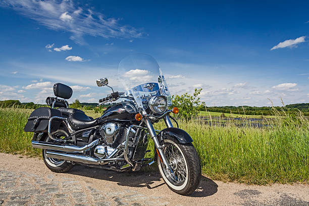 Kawasaki VN 900 Classic Szczecin, Poland - May 31, 2015: Heavy customized Kawasaki VN 900 Classic in side of the paved road through the cultivated fields and lakes  in a sunny day  kawasaki heavy industries stock pictures, royalty-free photos & images
