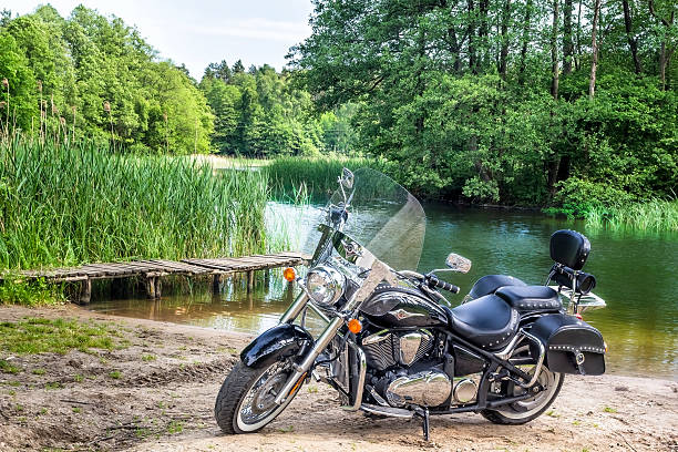 Kawasaki VN 900 Classic Drawsko Pomorskie, Poland - June 06,2015: Heavy customized motorcycle Kawasaki VN 900 Classic stands on the shores of the river Drawa, Zachodniopomorskie province, Poland  kawasaki heavy industries stock pictures, royalty-free photos & images