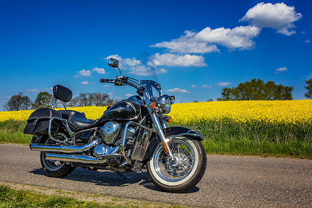 Kawasaki VN 900 Classic Szczecin, Poland - May 07, 2016: Heavy customized Kawasaki VN 900 Classic in side of the  road through the cultivated fields in a sunny day  kawasaki heavy industries stock pictures, royalty-free photos & images