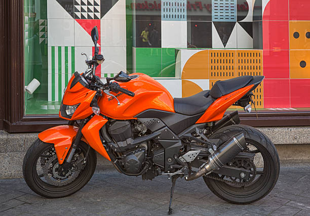 Kawasaki Z750 Amsterdam, Netherlands - August 1, 2016: The Kawasaki Z750 motorcycle is Kawasaki's model in the mid-end class of naked and half faired bikes. It is a smaller version of the Kawasaki Z1000. The Kawasaki Z750 was launched in 2004. kawasaki heavy industries stock pictures, royalty-free photos & images