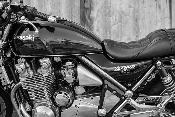 Kawasaki Zephyr motorcycle Subotica, Serbia - February 20th, 2016: Photo shoot of Kawasaki ZR 1100 Zephyr A1 bike from 1992, close up shoot of reservoir, engine cylinders and driver seat outdoors in front of the old garage.Four stroke transverse four cylinder. DOHC, 2 valves per cylinder. 1062cc, air cooled kawasaki heavy industries stock pictures, royalty-free photos & images