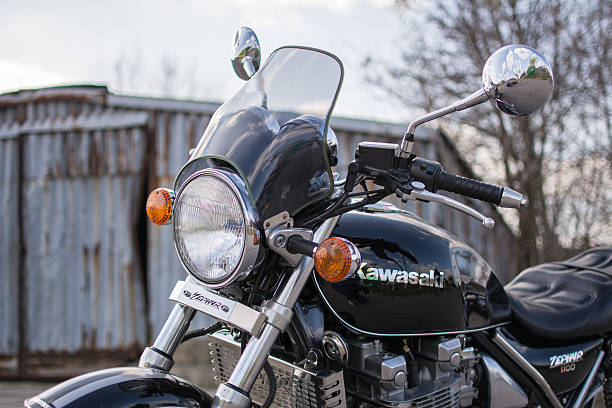 Kawasaki Zephyr motorcycle Subotica, Serbia - February 20th, 2016: Photo shoot of Kawasaki ZR 1100 Zephyr A1 bike from 1992, close up shoot of front of the bike from the left side and steering wheel, outdoors in front of the old garage.Four stroke transverse four cylinder. DOHC, 2 valves per cylinder. 1062cc, air cooled. kawasaki heavy industries stock pictures, royalty-free photos & images