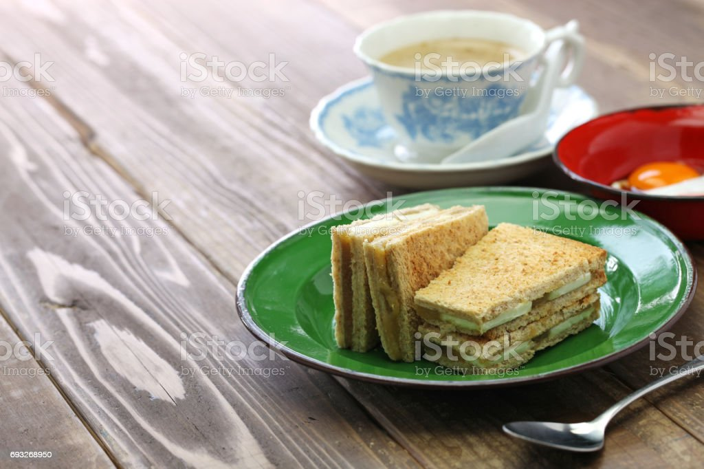 kaya jam toast with a cup of white coffee stock photo