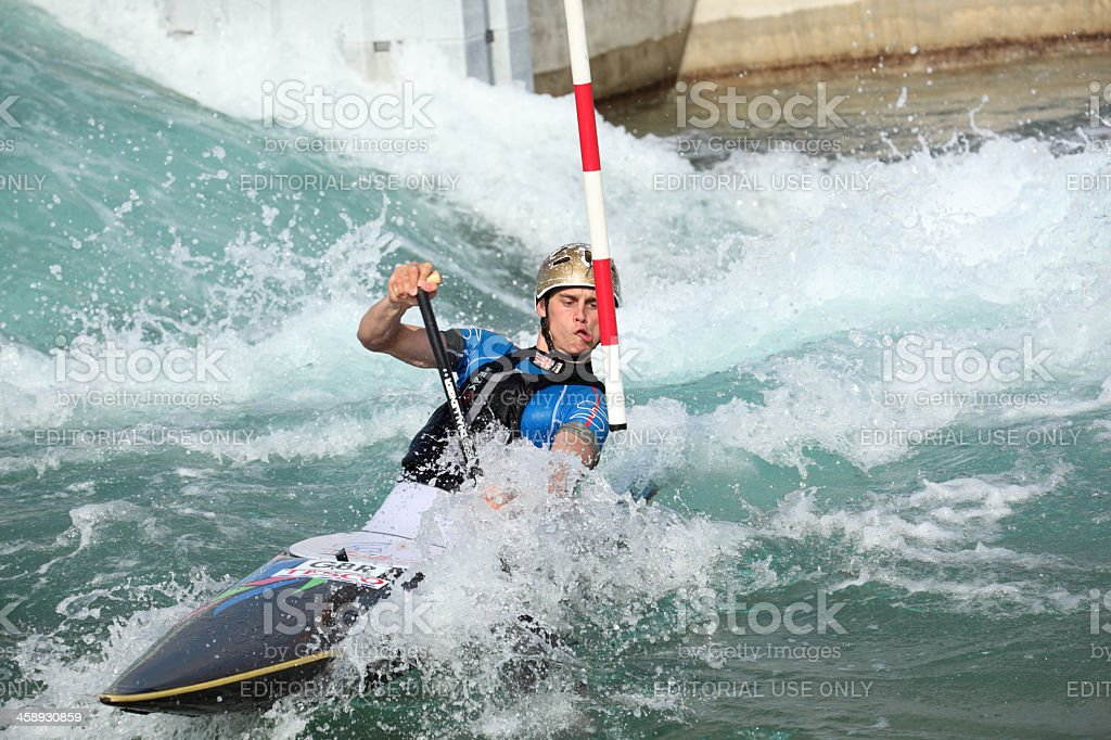 kayak and canoeist navigates white water rapids in slalom course stock photo