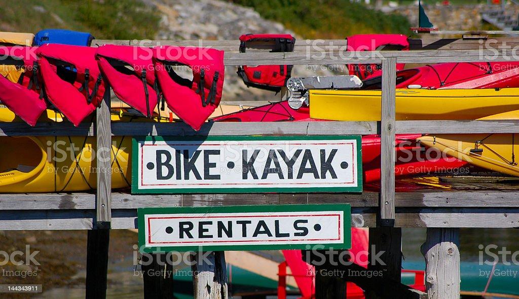 Kayak & Bike Sign stock photo