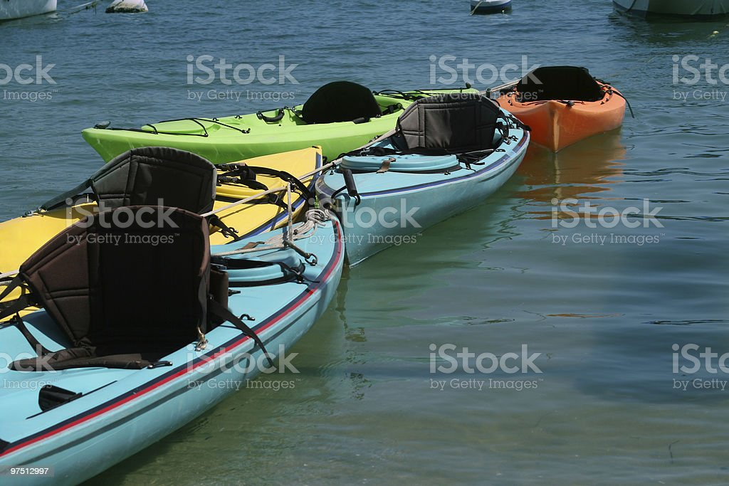 kayak boats tied together royalty-free stock photo