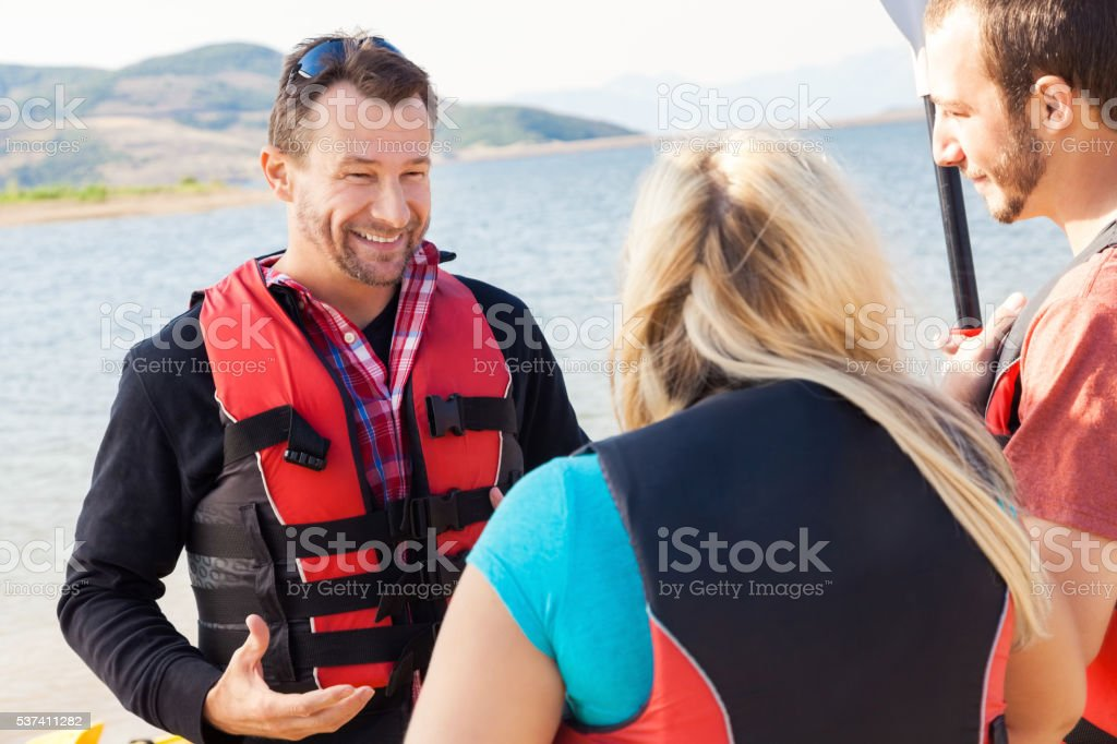 Kayak guide prepares kayakers stock photo