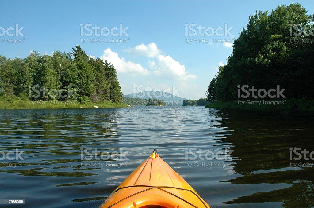 Kayak navigating a waterway royalty-free stock photo