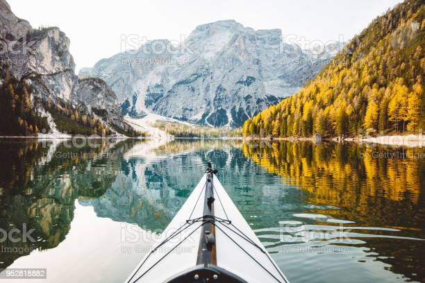 Photo of Kayak on a lake with mountains in the Alps