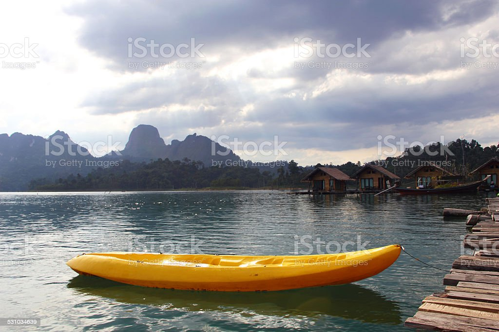 Kayak on Quiet Lake and cloudscape at Khao Sok stock photo