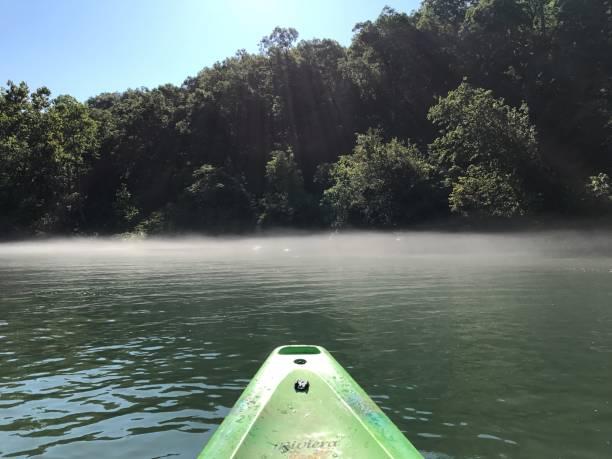 Kayak on river mist stock photo