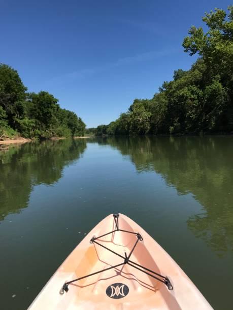 Kayak on river reflections stock photo