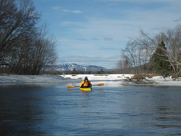 kayak surfer on an icy lake stock photo
