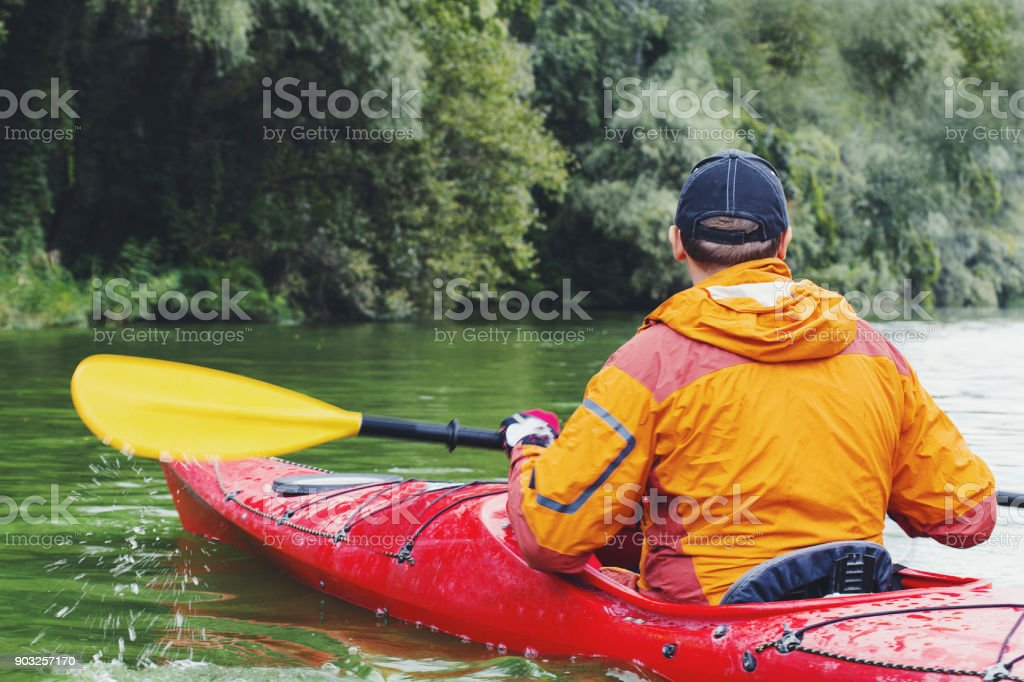 Kayak Water Sports Banner with Copy Space. Senior Kayaker on the...
