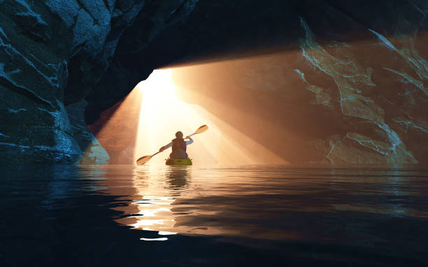 Kayaker afloating to the cave. This is a 3d render illustration stock photo