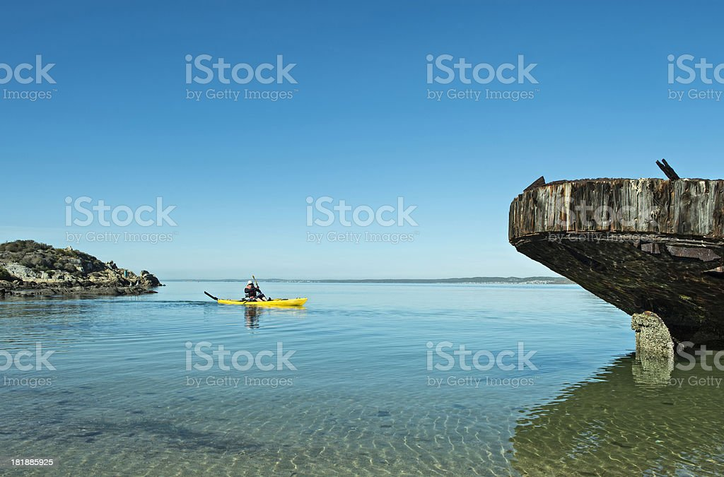 Kayaker approaches wreck royalty-free stock photo