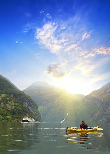 Kayaker  at Geiranger fjord, Norway stock photo