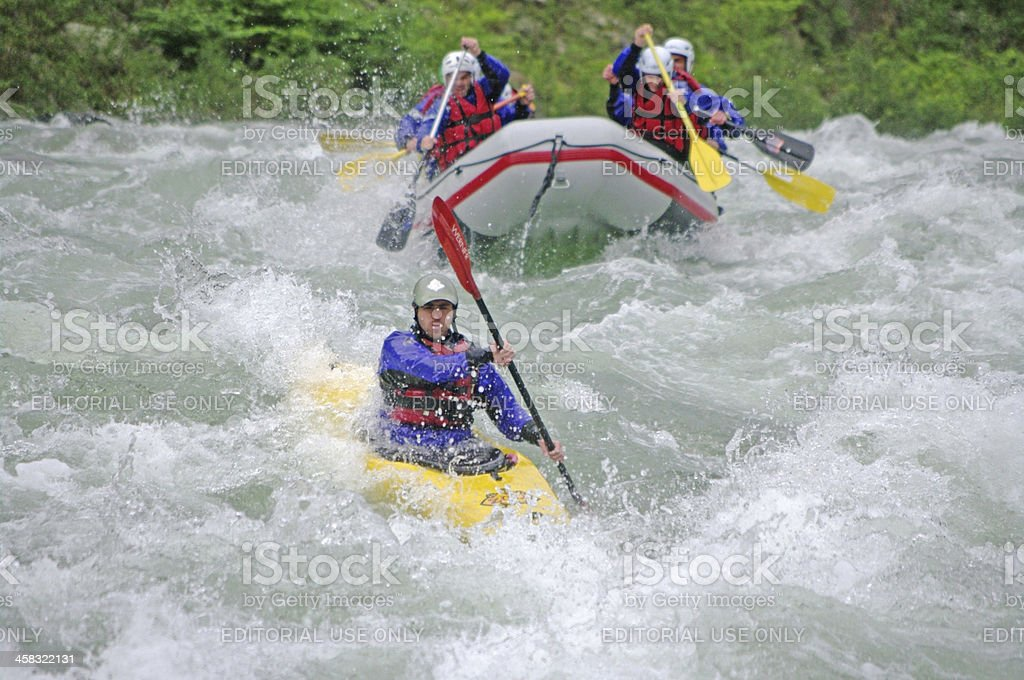 Kayaker down the river whit rafting team royalty-free stock photo