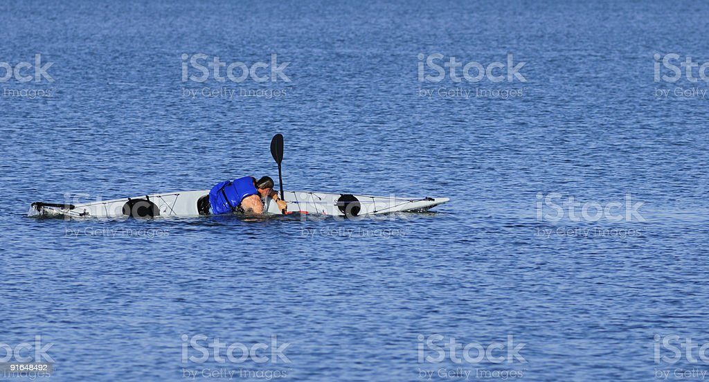 Kayaker emerges during a float-assisted roll royalty-free stock photo