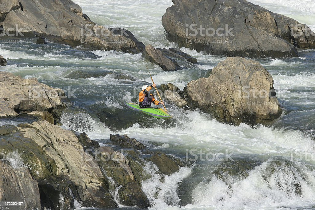 Kayaker Going Over the Falls royalty-free stock photo