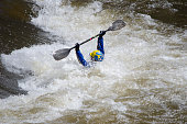 Buena Vista, United States - May 28, 2011: A kayaker manuevers his boat through powerful whitewater rapids during spring runoff on the Arkansas River in Buena Vista, Colorado.