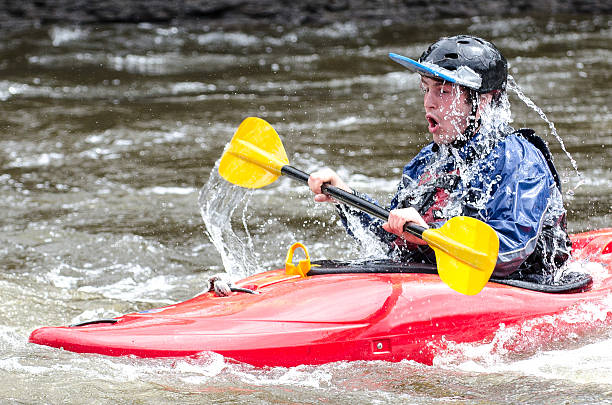 kajakfahrer rolling out of water - roll tide stock-fotos und bilder