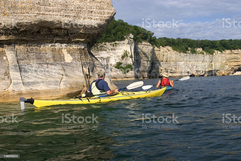 Kayakers Along Cliffs stock photo
