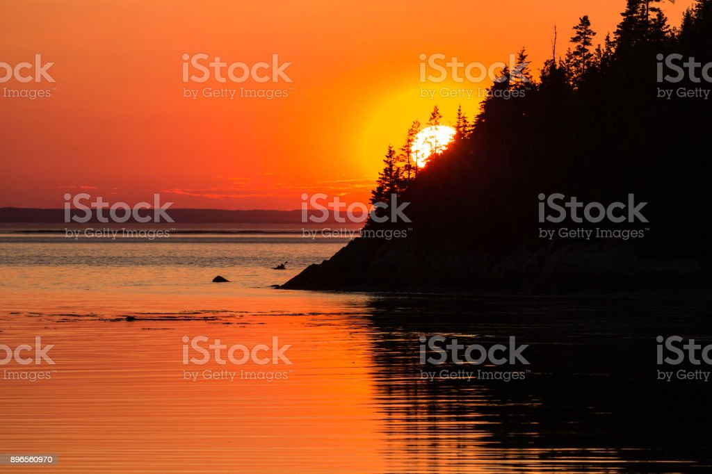 Kayakers at Sunset in Bic National Park at Sunset, Quebec, Canada