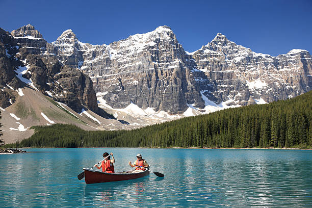 Kayakers, Canadian Rockies  valley of the ten peaks stock pictures, royalty-free photos & images