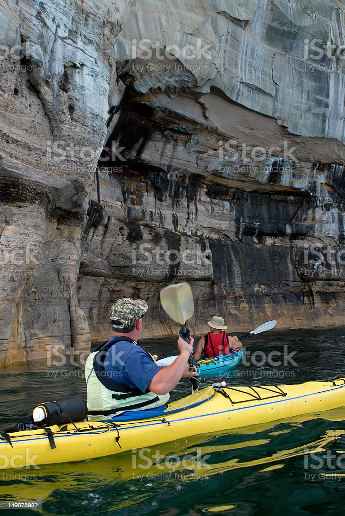 Kayakers & Cliffs stock photo