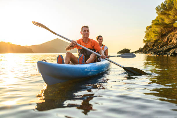 Kayakers Enjoying Healthy Lifestyle in Mediterranean at Dawn stock photo