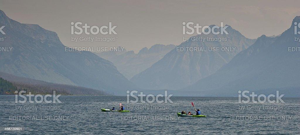 Kayakers on Lake McDonald royalty-free stock photo