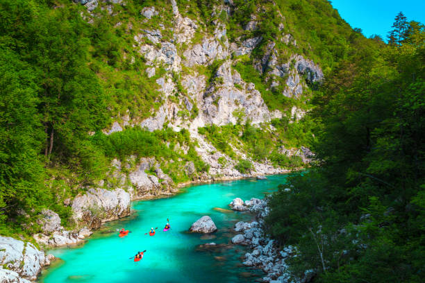Kayakers on the spectacular turquoise Soca river, Kobarid, Slovenia stock photo