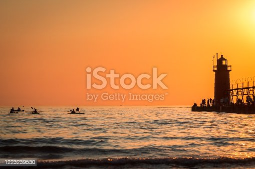 177362898 istock photo kayakers paddling near the South Haven lighthouse in Michigan 1223239530