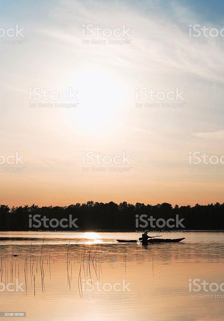 Kayaking across lake stock photo