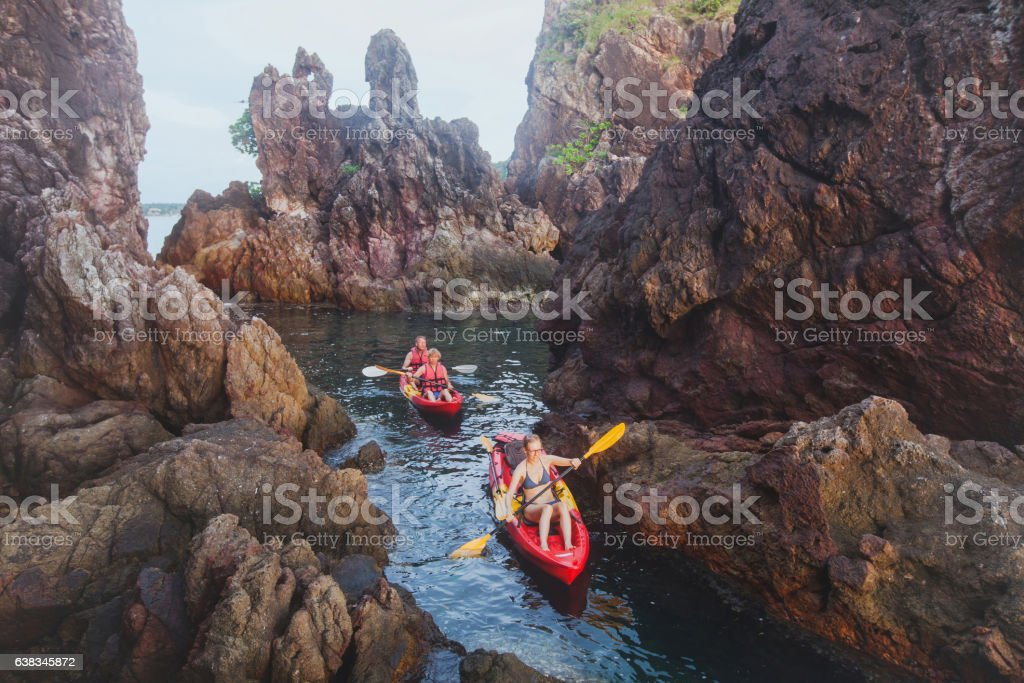 kayaking, adventure travel, group of people on kayaks stock photo
