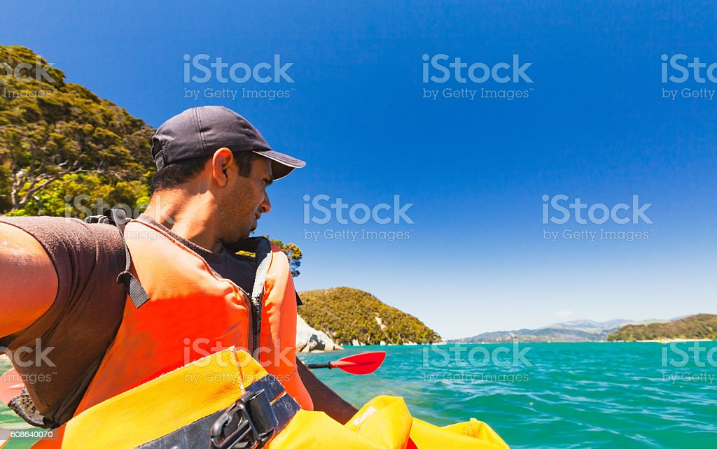 Kayaking at Able Tasman National Park. stock photo
