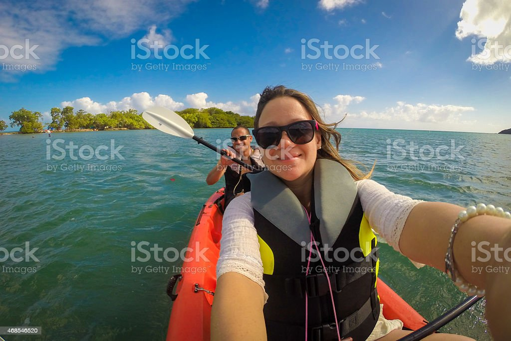 kayaking couple stock photo